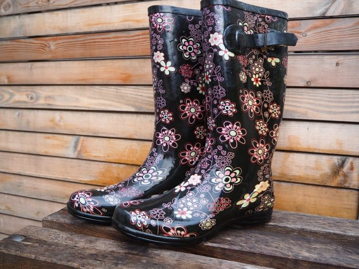 black rubber rain boots with pink and white flowers