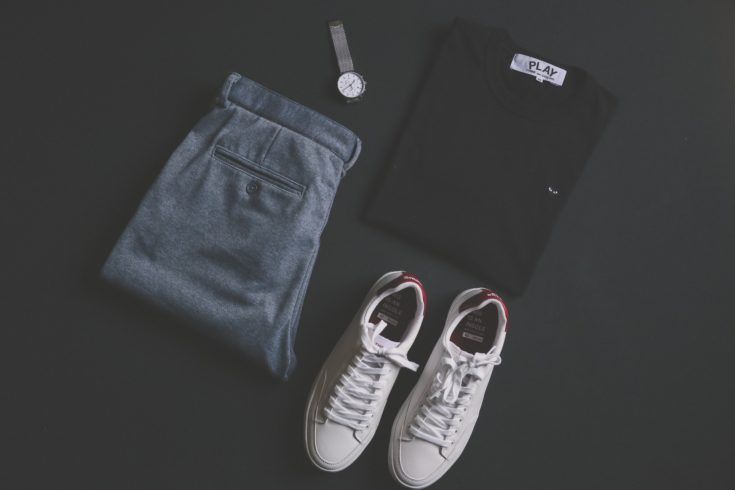 Mens white sneakers with gray slacks, black shirt and watch