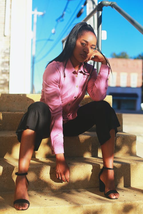 pink button up shirt with black ruffle capris and black strappy high heel sandals