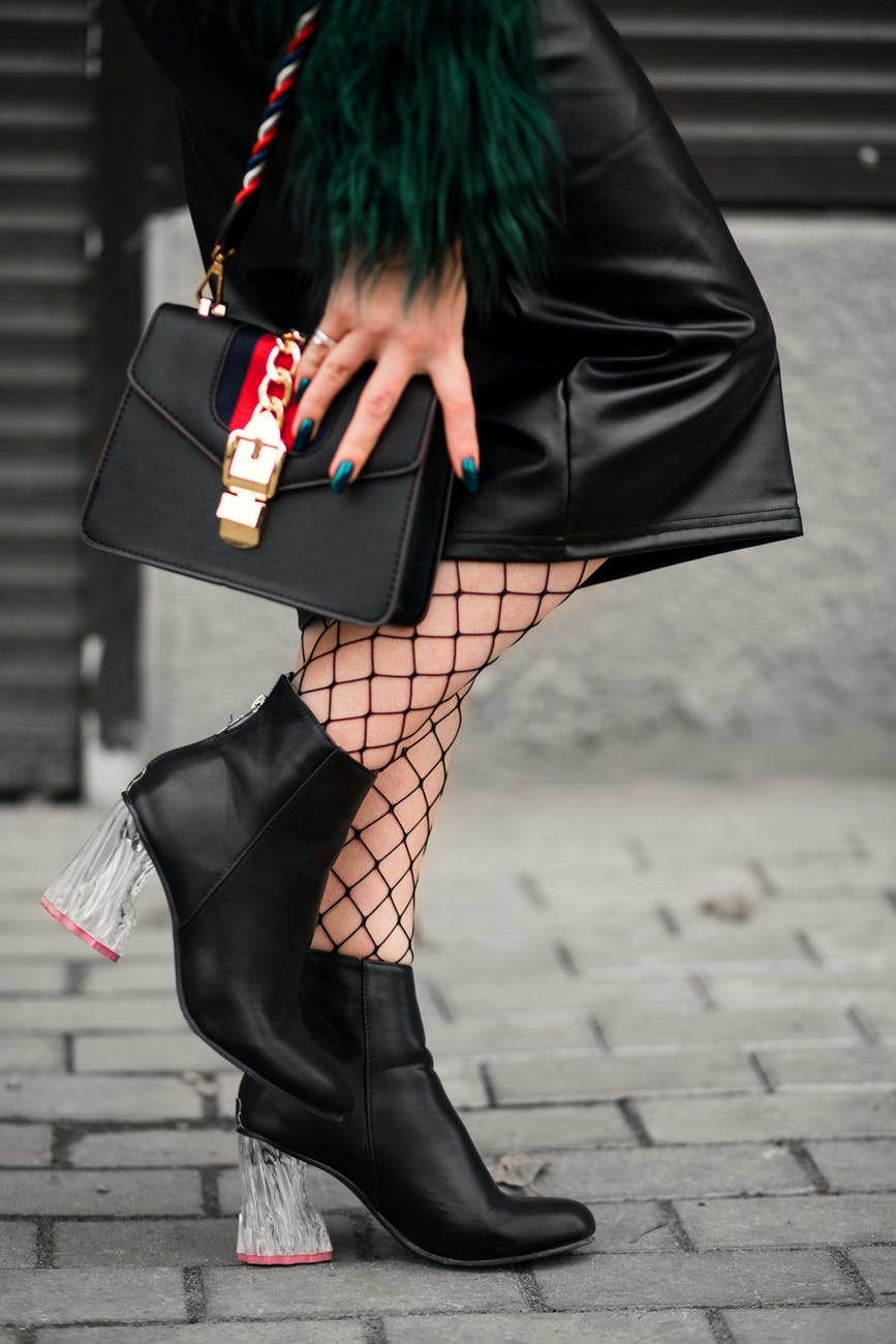 chunky clear heels on black ankle boots